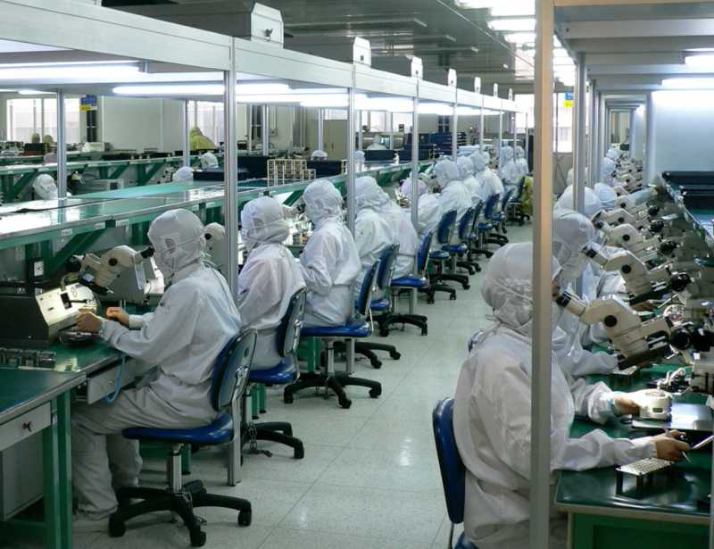 factory workers assembling electronic products