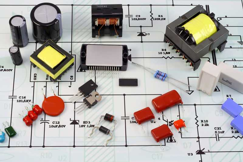 electronic components on top of printed schematic circuit diagram